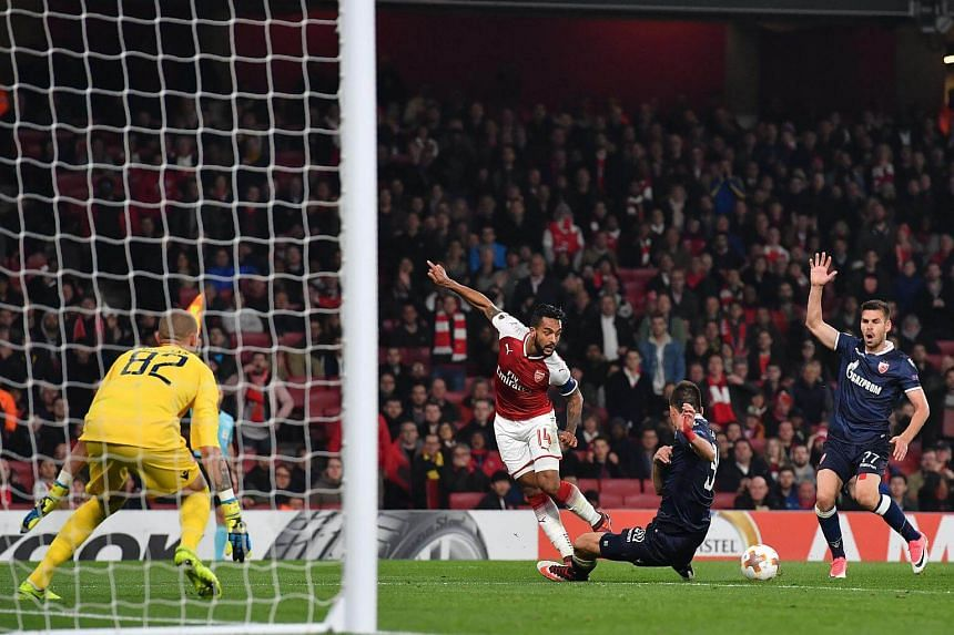 Arsenal's English midfielder Theo Walcott misses an attempt at goal during the match between Arsenal and Red Star Belgrade.