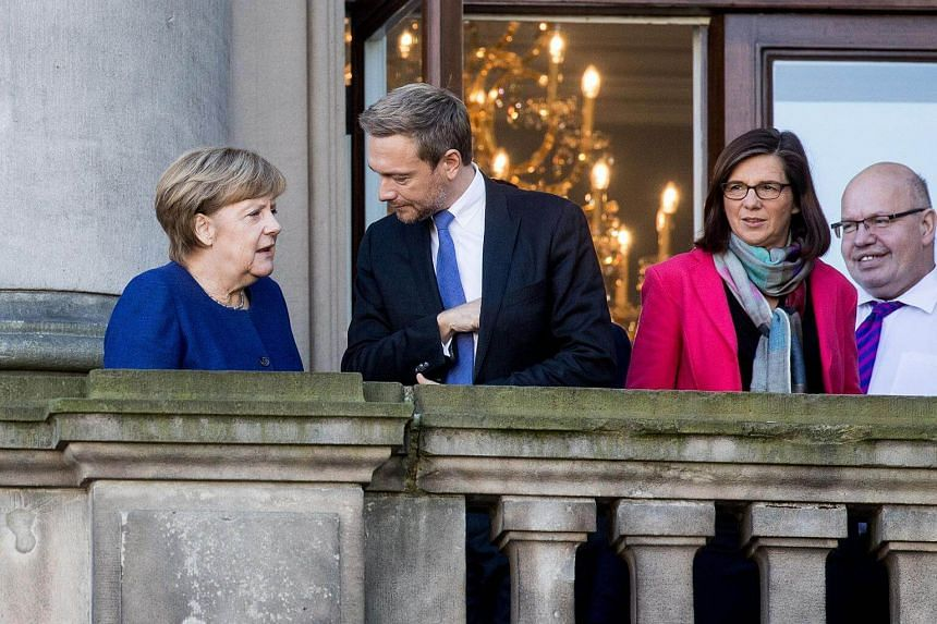 (Left to right) German Chancellor Angela Merkel, chairman of the Free Democratic Party (FDP), Christian Lindner, parliamentary group co-leader of the Greens ecologist party, Katrin Goering-Eckardt and German Chief of Staff Peter Altmaier stand on the
