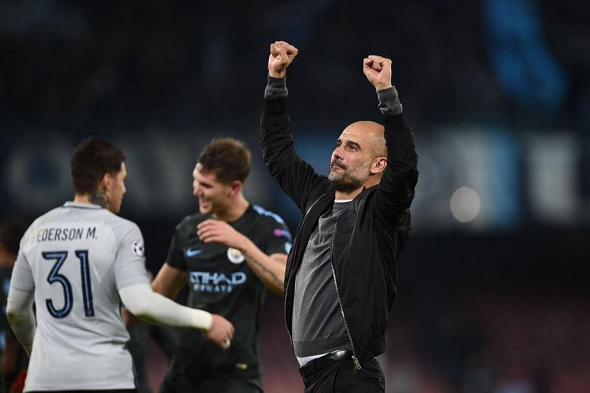 Manchester City's Spanish manager Pep Guardiola celebrates at the end of the match between Napoli and Manchester City on Nov 1.