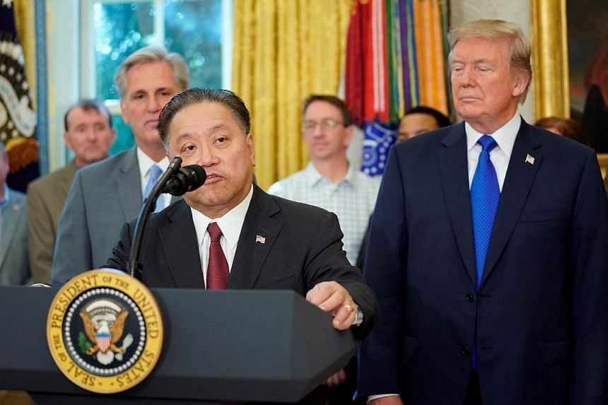 Broadcom CEO Tan Hock E. speaks after US President Donald Trump delivered remarks about the situation of the job market.