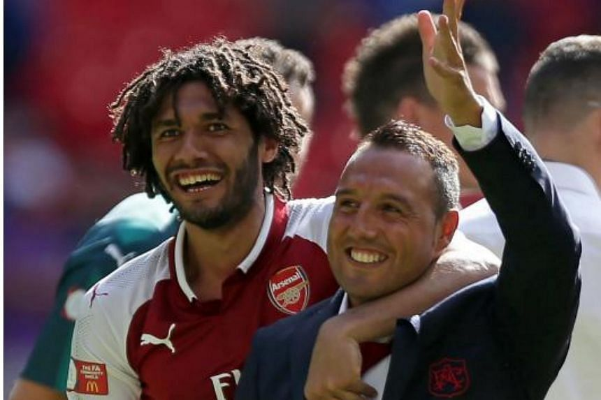 Arsenal midfielder Santi Cazorla (in black) has not played since a 6-0 Champions League victory over the Bulgarian side Ludogorets last October.