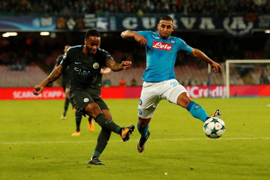 Manchester City's Kevin De Bruyne in action with Napoli's Faouzi Ghoulam. The Algerian limped off after half an hour of the match.