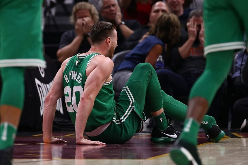 Gordon Hayward sits on the floor after being injured while playing the Cleveland Cavaliers at Quicken Loans Arena on Oct 17, 2017.