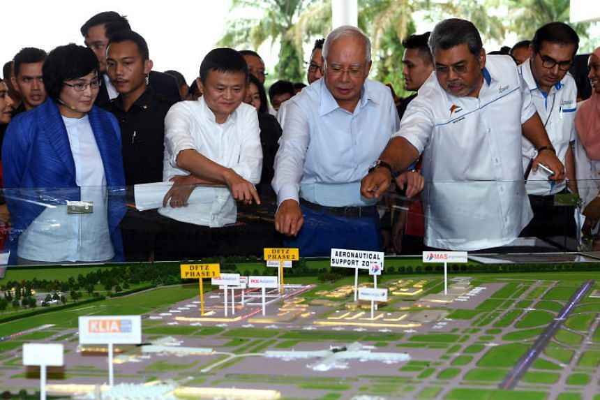 Malaysian Prime Minister Najib Razak with Jack Ma looking at a model of the Digital Free Trade Zone at its launch in Sepang on Nov 3, 2017.