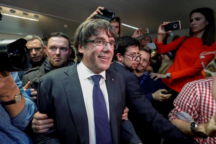 Sacked Catalan leader Carles Puigdemont departs after giving a news conference at the Press Club Brussels Europe.