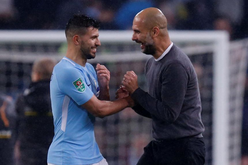 Manchester City's Sergio Aguero and Manchester City manager Pep Guardiola celebrate after the match, Manchester City v Wolverhampton Wanderers, on Oct 24.