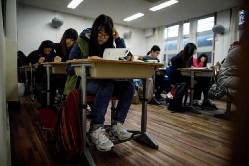 Students sit the annual Scholastic Aptitude Test at a the Poongmun high school in Seoul.