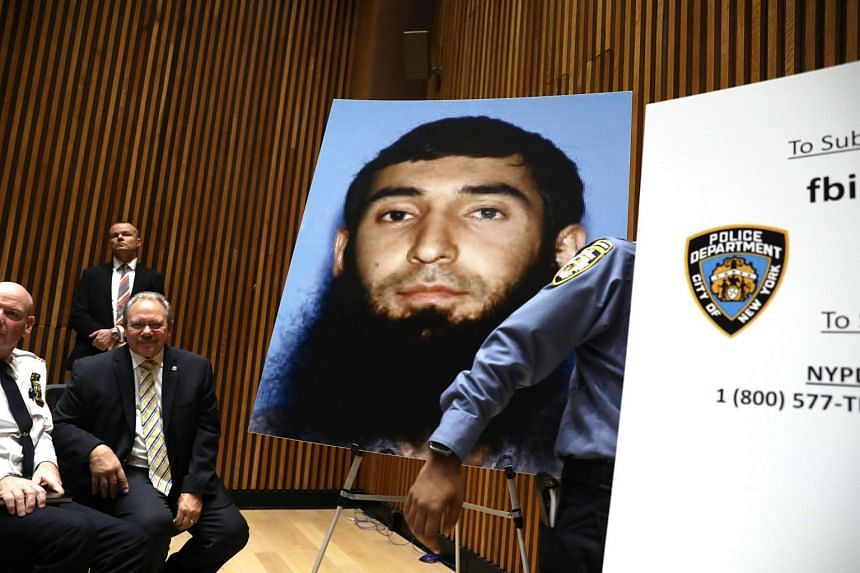 A picture of suspect Sayfullo Saipov is displayed during a news conference about the attack along a bike path in lower Manhattan.