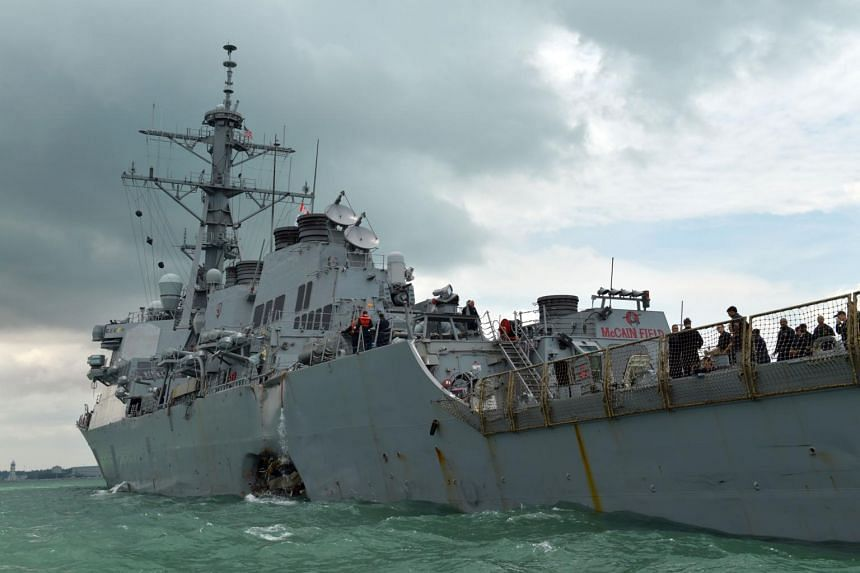 The US Navy destroyer USS John S. McCain with the damage on its port side, seen off Changi Naval Base on Aug 21.