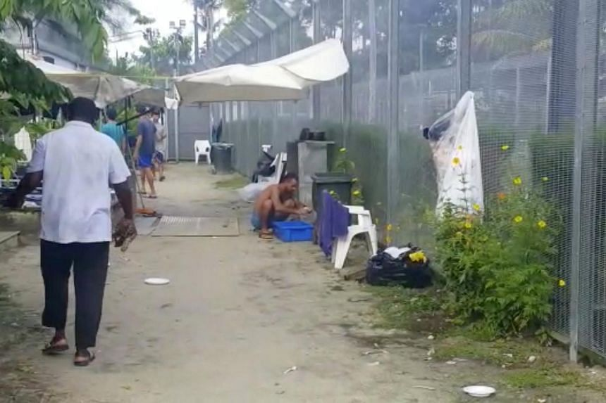 Asylum seekers modify a man-made well at a detention centre on Manus Island, Papua New Guinea.