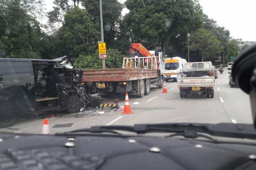 Photos circulating online show a black van with its front part crushed.