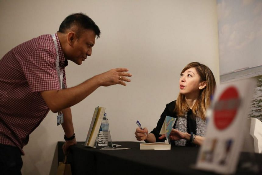 Sumiko Tan signs books at the Singapore Writers Festival.