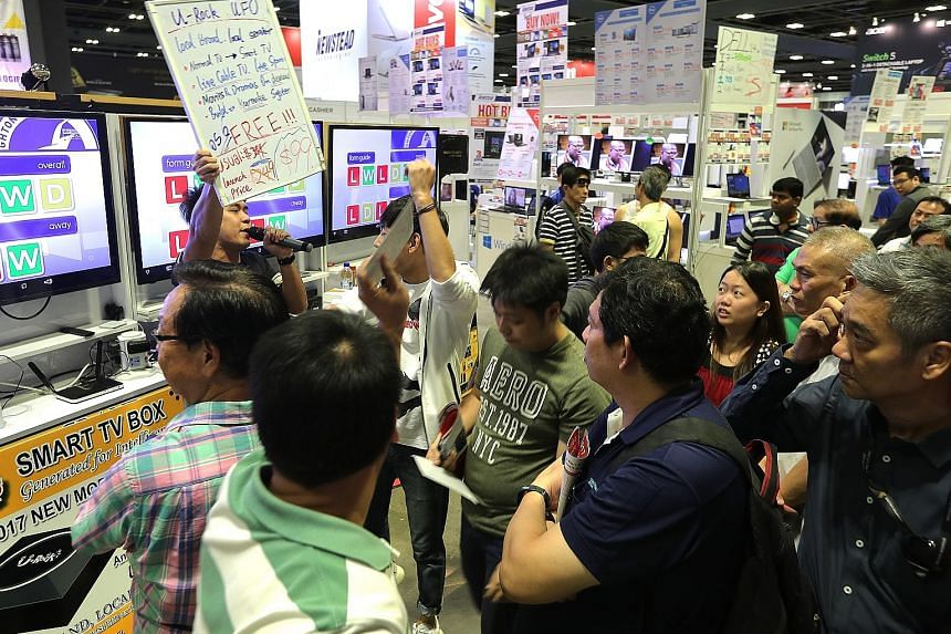 Visitors to this year's Consumer Electronics Fair are eligible for a lucky dip with no minimum spending required. The event at Suntec Convention and Exhibition Centre is on till tomorrow.