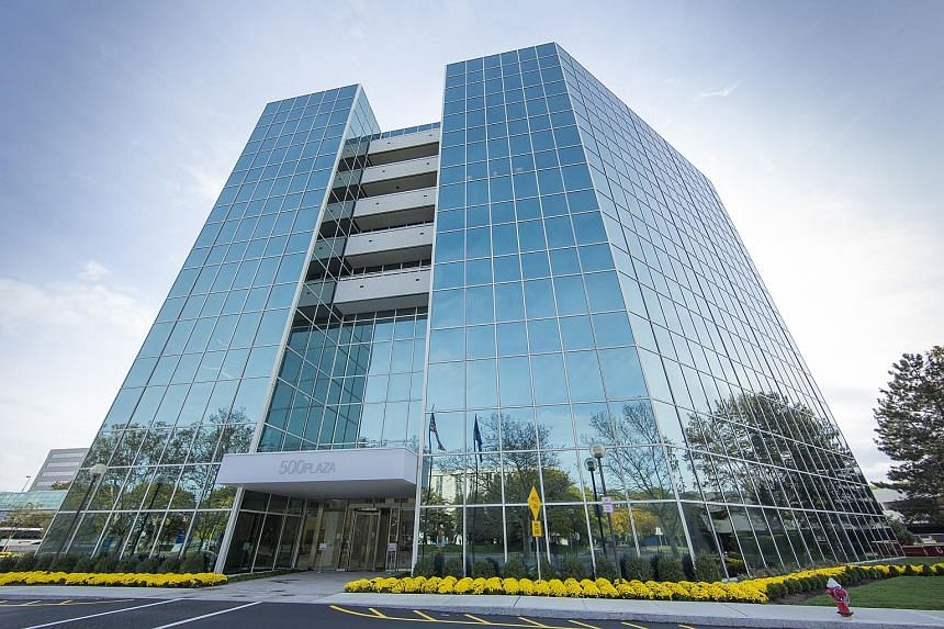 Manulife US Real Estate Investment Trust's maiden acquisition, 500 Plaza Drive in New Jersey. The Reit's gross revenue of US$23 million (S$31.3 million) beat its projection by 16.8 per cent for the quarter due to income from 500 Plaza Drive, among ot