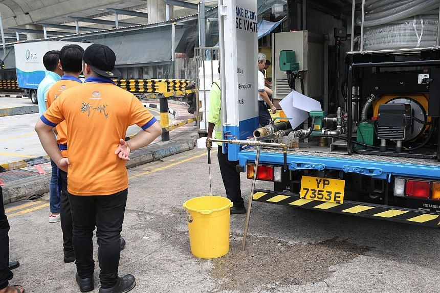 Clockwise from far left: A water pipe leak within a construction site at the junction of Tampines Avenue 5 and Tampines Central 2 yesterday affected water supply to the bus interchange and food stores in the area; food and beverage staff collecting w