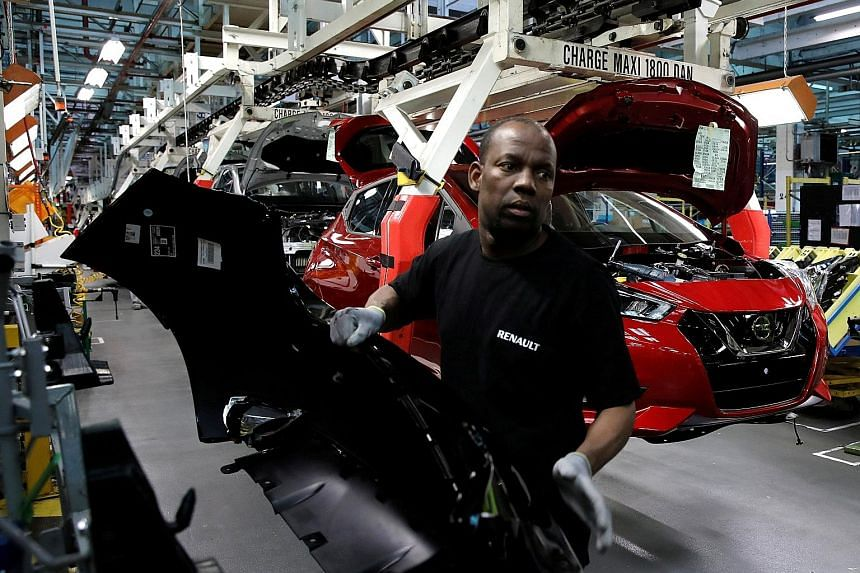 The assembly line of the Nissan Micra at the Renault car factory in Flins, near Paris, France. Renault acquired 1.4 million shares as part of the transaction and plans to offer them to employees, the company said yesterday.