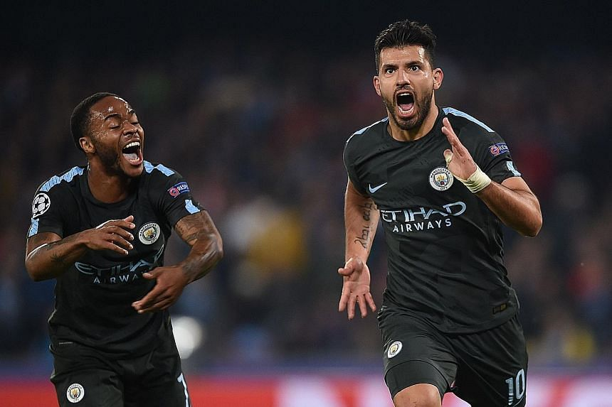 Manchester City's Sergio Aguero (right) celebrating with Raheem Sterling after scoring his record 178th goal for the club during the 4-2 Champions League win against Napoli on Wednesday.