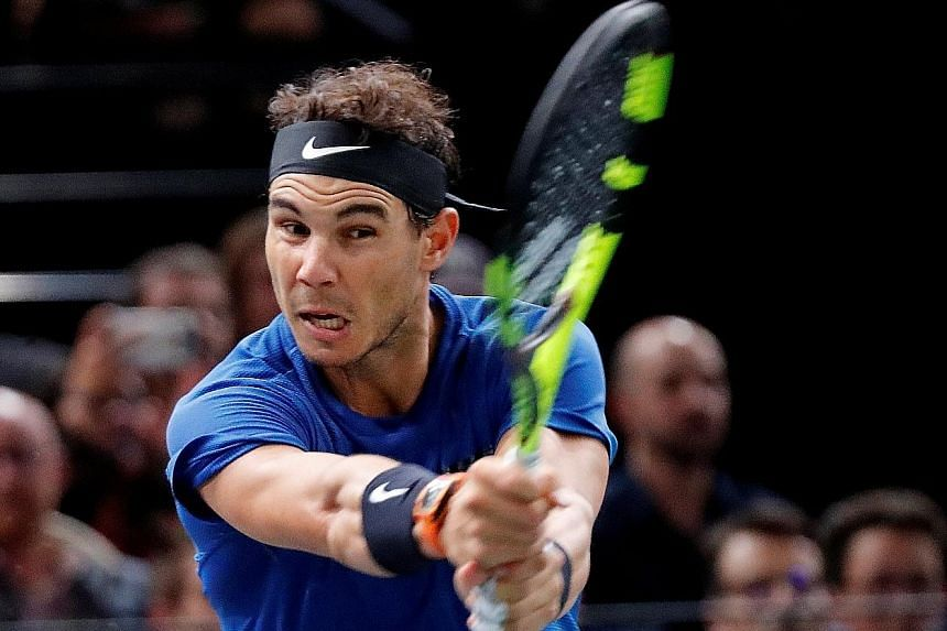 Rafael Nadal in action against Pablo Cuevas during the third round of the Paris Masters. The world No. 1 is in doubt for the Tour Finals.