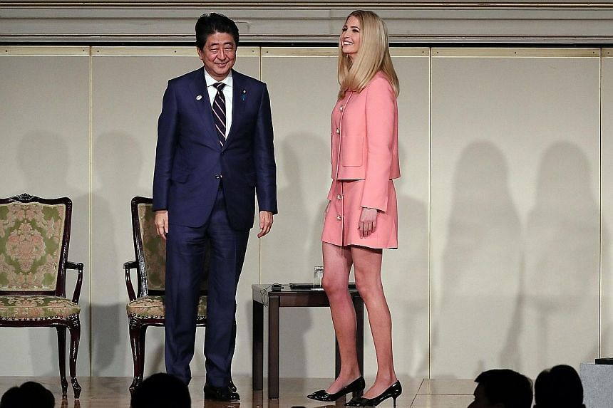 Japan's Prime Minister Shinzo Abe and Ms Ivanka Trump at the World Assembly for Women in Tokyo yesterday. Ms Trump is a supporter of the Women's Entrepreneur Finance Initiative.