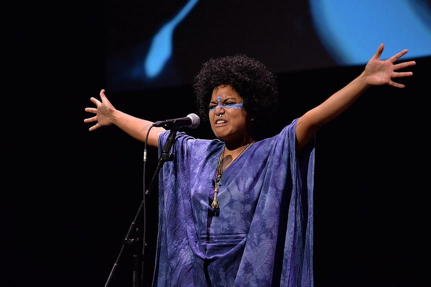 Poet-musician Deborah Emmanuel performing festival-commissioned song Ocean Free at the opening of the Singapore Writers Festival yesterday.