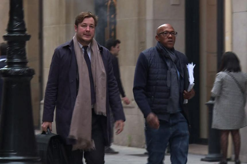 An image grab from an AFP TV video shows IOC member Frankie Fredericks (right) arriving at the financial crimes court building in Paris on Nov 2, 2017 as part of a probe into graft allegations over the awarding of the 2016 Olympics to Rio.