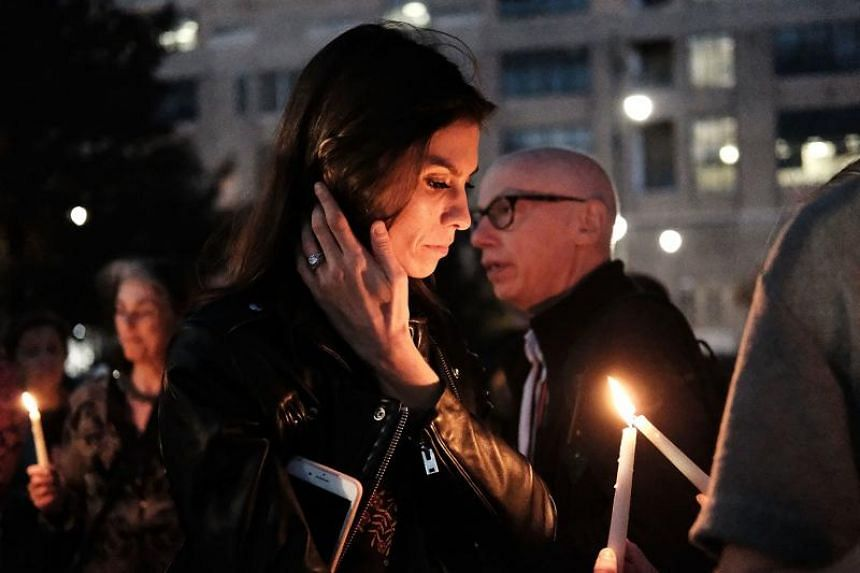 People converge with candles for a vigil to walk along a bike path in Lower Manhattan on Nov 2, 2017 in New York City.