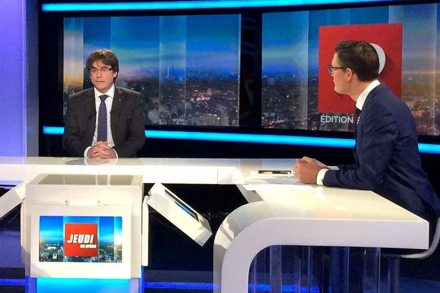 Ousted Catalan President Carles Puigdemont is interviewed on Belgian RTBF television in Brussels, Belgium on Nov 3, 2017.