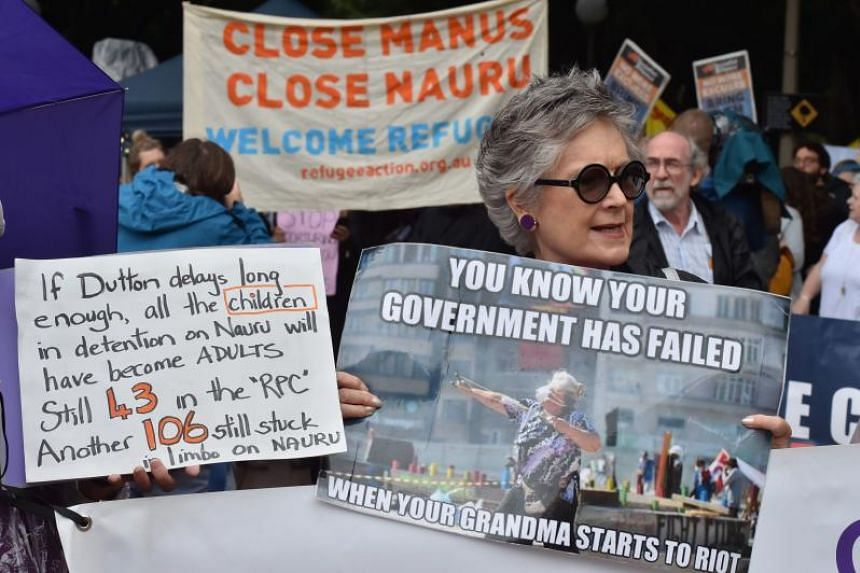 Protesters hold a rally in Sydney to urge the Australian government to end the refugee crisis on Manus Island on Nov 4, 2017.