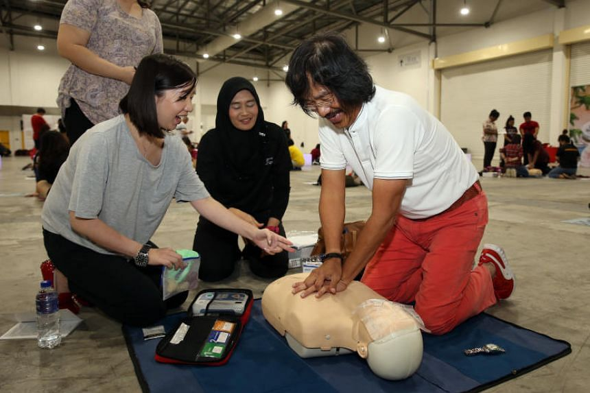 Mr Yeo Guan Kai, a cardiac arrest survivor, went through the three-hour CPR and AED course with his daughter Nicole Yeo (left).
