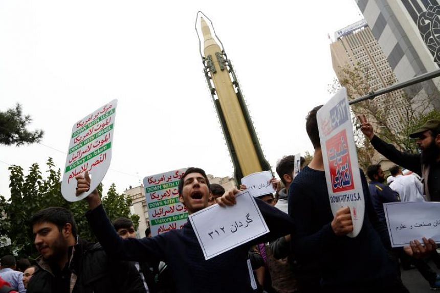 Iranians take part in a demonstration marking the 38th anniversary of the US Embassy takeover, in front of the former US embassy in Teheran, Iran on Nov 4, 2017.