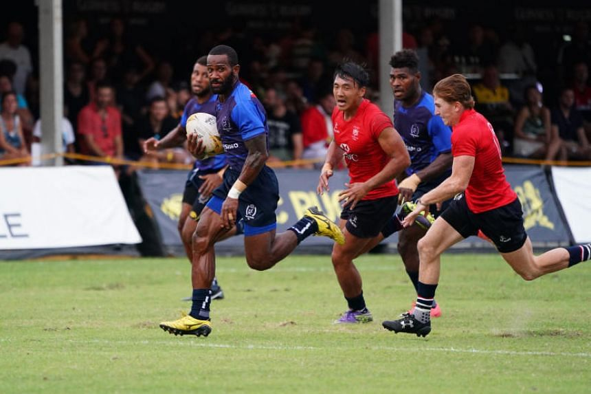 Daveta's Lemeki Tulele (second from left) in action against the Hong Kong Dragons during the Ablitt Cup pool match of the Singapore Cricket Club Rugby Sevens on Saturday (Nov 4).