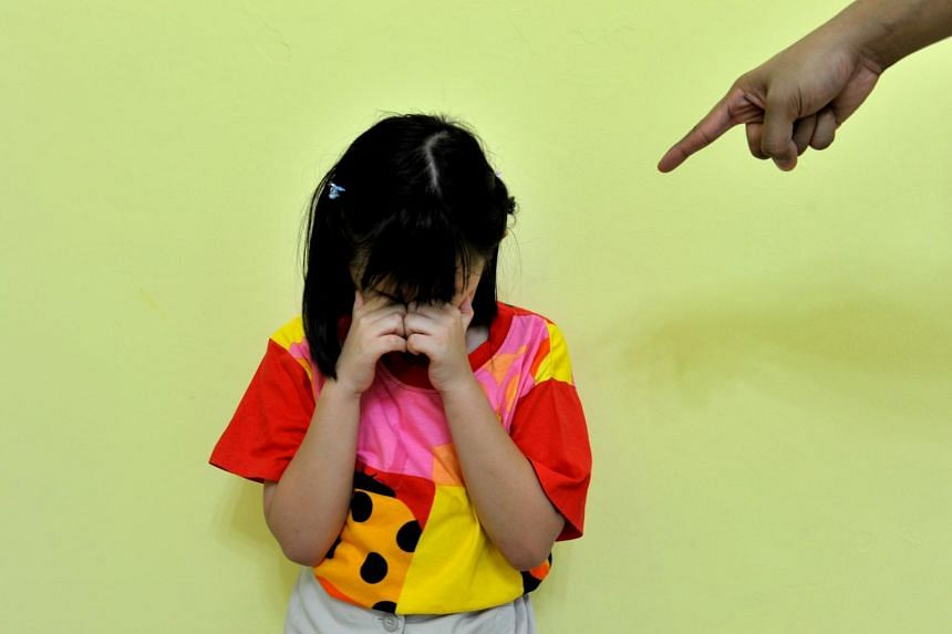 A posed photo of a child cyring. A teacher in Petaling Jaya had allegedly slapped a student on both sides of her face until she bled from her ears.