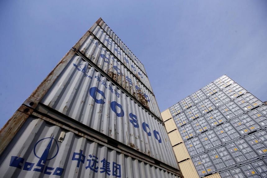 Containers from China Ocean Shipping Company (Cosco) are pictured at a port in Shanghai.