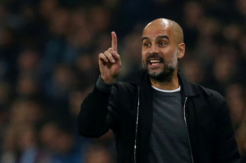 Manchester City manager Pep Guardiola gesturing during a match.