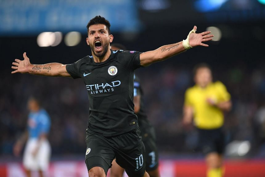 Manchester City's Argentinian striker Sergio Aguero celebrates after scoring during the match between Napoli and Manchester City on Nov 1.