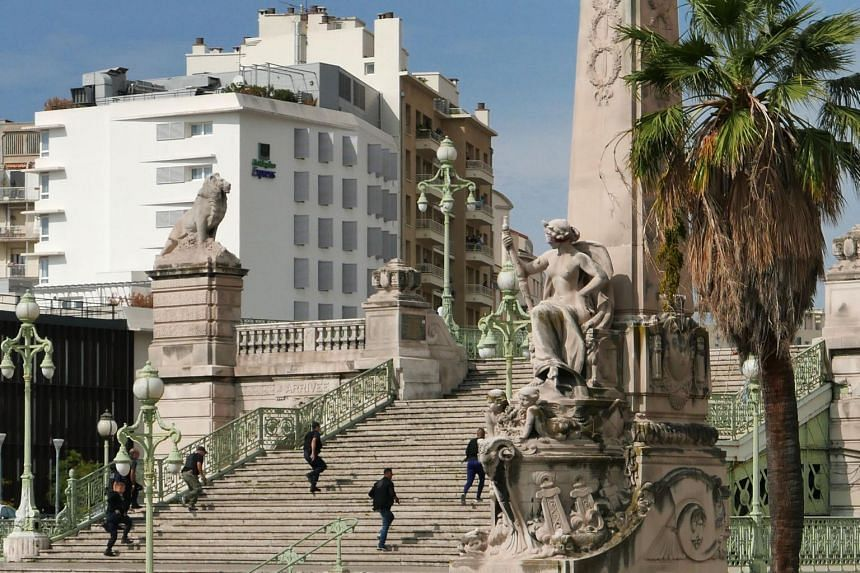 French police rush to the Saint-Charles main train station in Marseille, southern France, as a suspected Islamist knifeman killed at least two people before being shot and killed by soldiers patrolling there.