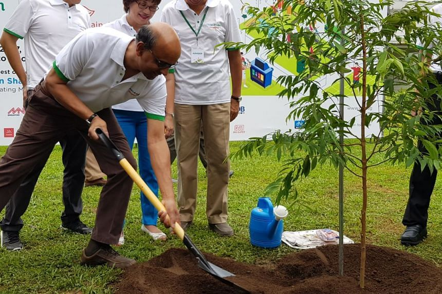 DPM Tharman Shanmugaratnam planting a tree at the annual Clean and Green carnival on Nov 4.