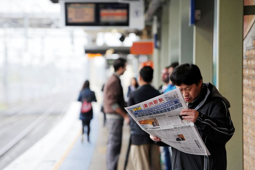 A man reading a Chinese language newspaper at a train station in Cabramatta, south-west of Sydney, Australia. Professor Feng Chongyi of the University of Technology Sydney says the influence exerted by Beijing over Chinese associations in Australia h