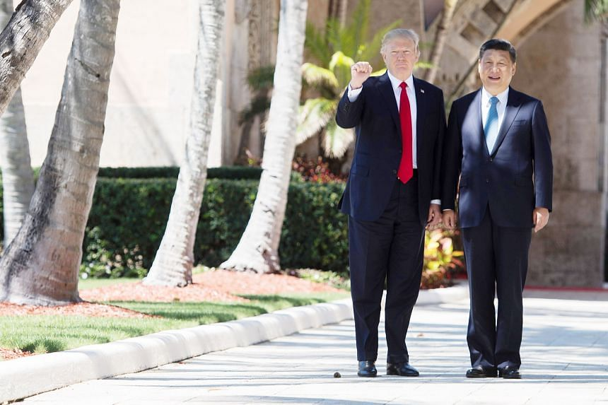 US President Donald Trump and his Chinese counterpart Xi Jinping in West Palm Beach, Florida, in April. The writer says Asian leaders can see that Mr Trump is becoming politically weaker at a moment of historic strength and confidence for Mr Xi.