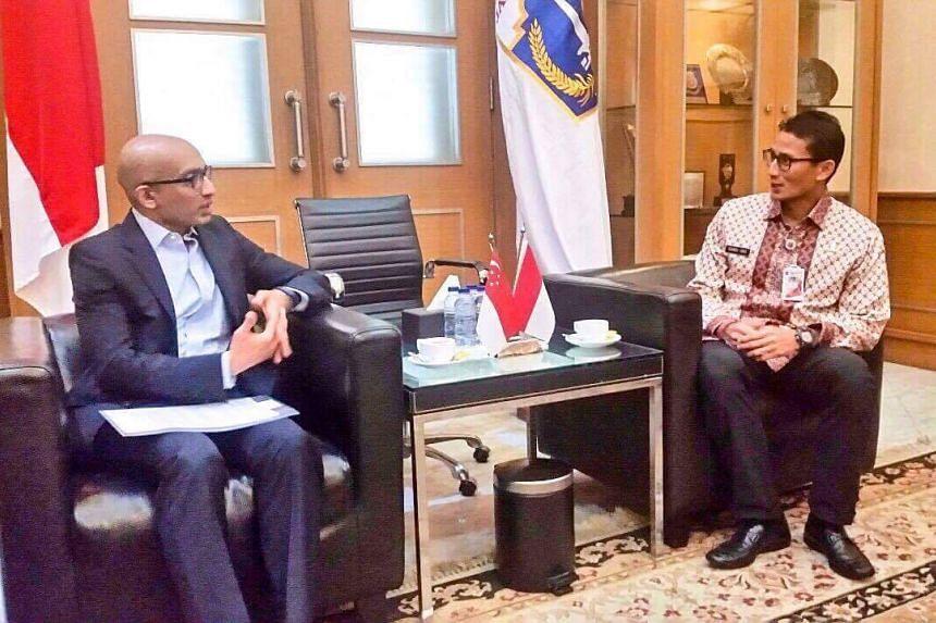 Ambassador Anil Nayar (left) from Singapore speaks to Jakarta's deputy governor Sandiaga Uno.