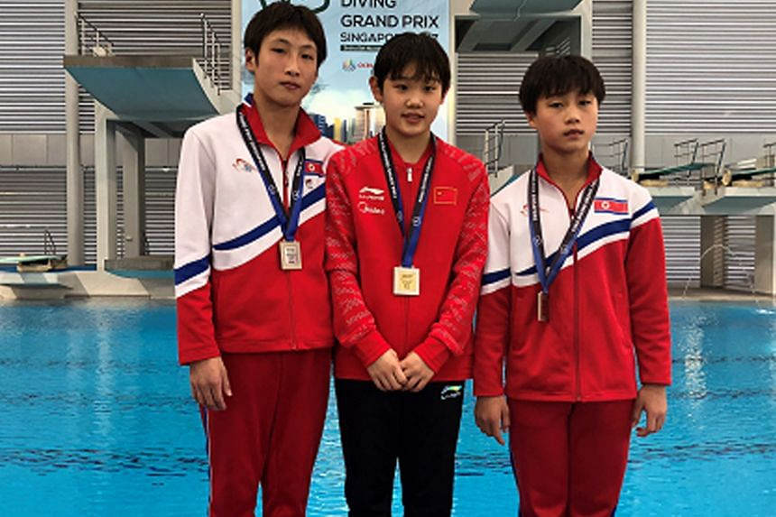 Women's 10m platform medallists (from left) North Korea's Kim Mi Hwa (silver), winner Zhang Jiaqi of China, and North Korea's Kim Kwang Hui (bronze) at the OCBC Aquatic Centre on Nov 4, 2017.