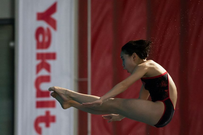 China's Zhang Jiaqi, 13, in the women's 10m platform at the Fina Diving Grand Prix Singapore on Nov 4, 2017 at the OCBC Aquatic Centre. She won with 400.75 points.
