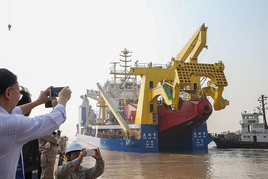 The ship, named Tian Kun Hao, was launched last Friday at a port in Jiangsu province and has been described as Asia's largest dredging vessel. The ship is capable of building artificial islands and will be able to dig 6,000 cubic m an hour, said Chin