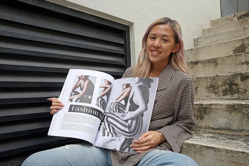 Ms Charlene Yong, who has psoriasis, with a fashion book she developed to combat stigmatisation of the condition. Called I'm Not Sick, it features psoriasis patients in clothes they wished to wear but did not dare to, and was done as her final-year p
