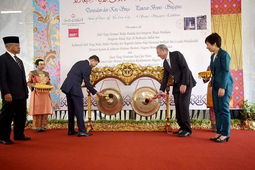 Brunei's Crown Prince Haji Al-Muhtadee Billah (left) and Singapore's Deputy Prime Minister Teo Chee Hean as well as Ms Grace Fu, Minister for Culture, Community and Youth, at the launch of the exhibition on the two countries' relations yesterday.