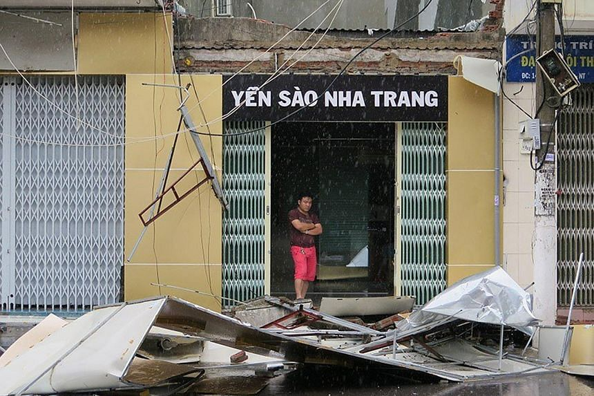 A man surveying the debris from a damaged house in Nha Trang after Typhoon Damrey made landfall in southern Vietnam yesterday. At least six people are missing, said the government.