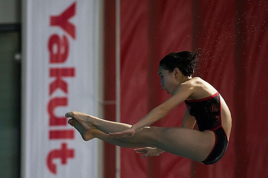 China's Zhang Jiaqi, 13, executes one of her dives during the women's 10m platform final in the Singapore leg of the Fina Diving Grand Prix at the OCBC Aquatic Centre yesterday. Jiaqi's winning score of 400.75 points is more than 50 points ahead of N