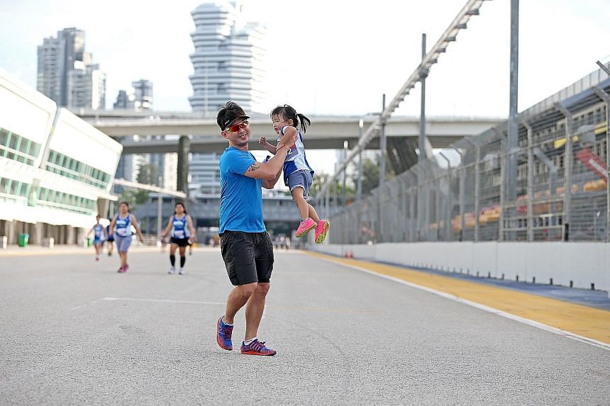 A father and his daughter taking part in the Straits Times Run In The City in July this year. Researchers found that support from family members and gamification can motivate people to exercise more.