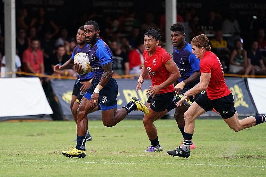 Daveta's Lemeki Tulele runs with the ball against the Hong Kong Dragons during their Singapore Cricket Club Rugby Sevens pool match yesterday.