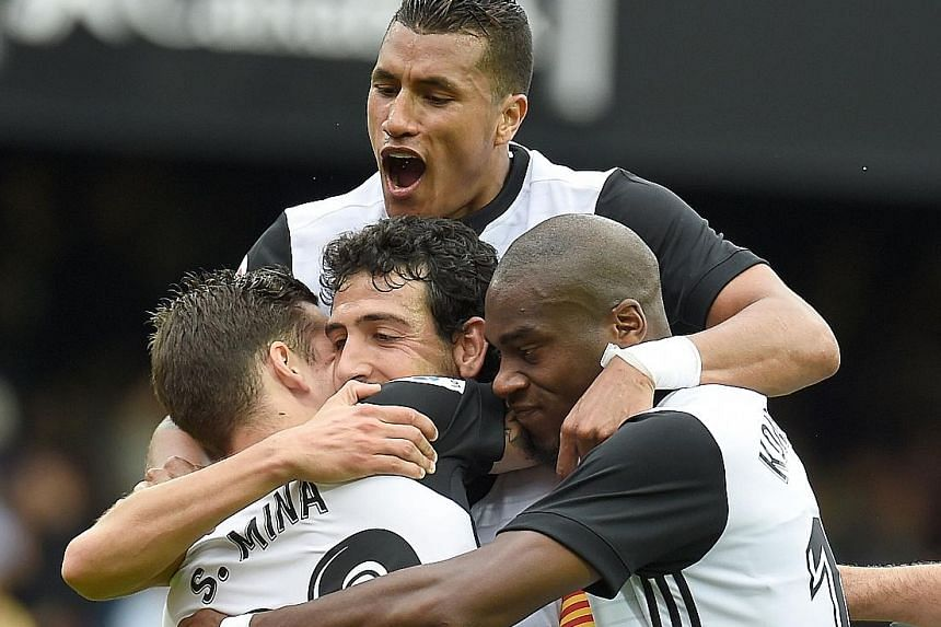 Valencia players celebrating the goal by Santi Mina that sealed their 3-0 win over Leganes and second position in the LaLiga table. Marcelino's men are the first side in Spain's top flight to score 30 goals in the league this season.